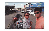Me and my famous cousin Hector at the border between United States and Mexico. Look at the signs for proof. Again, my trusty K75S.